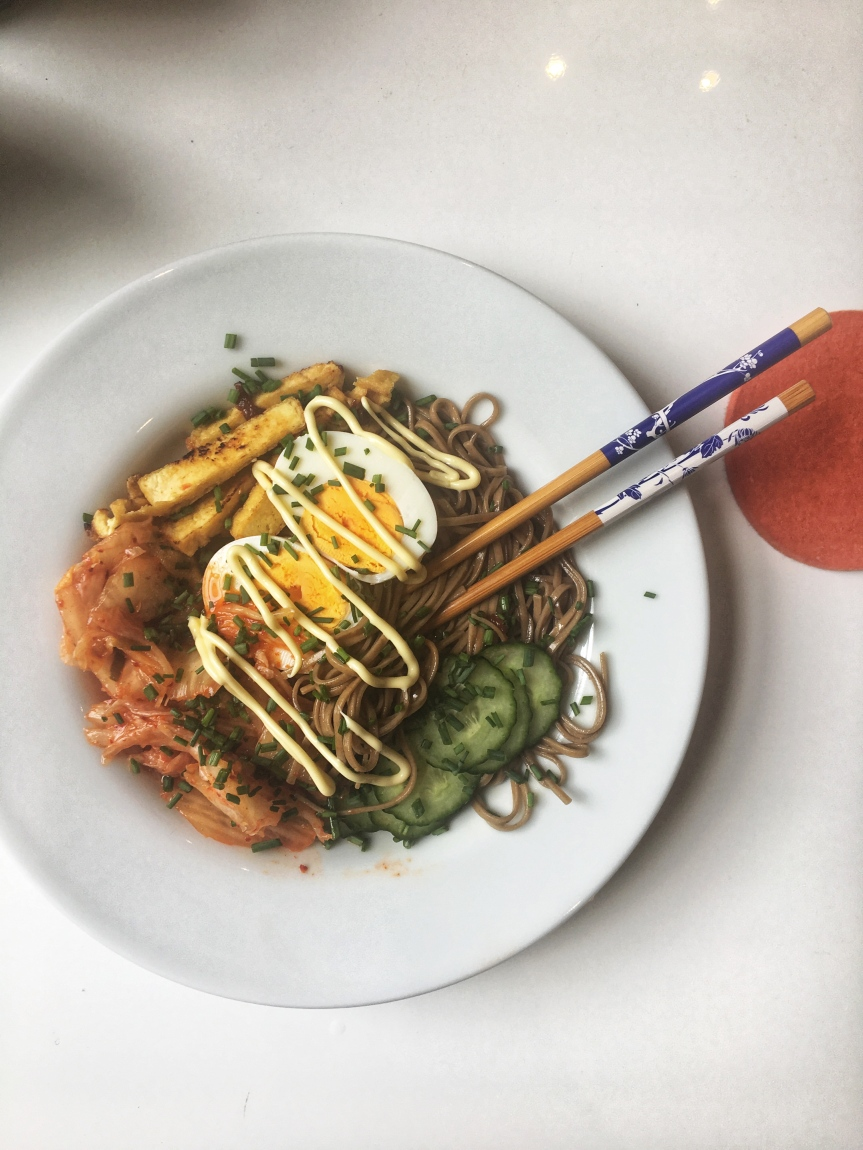 Soba Noodles with tofu, kimchi and cucumber and anegg